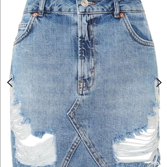 15acc1eec8 Topshop Moto Rip Denim Mini Skirt. M_5a6cd467a4c485cb3e9407bc